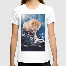 Cute kitten plays in sneakers T-shirt