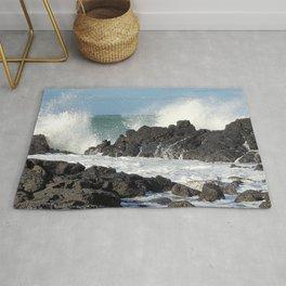 The waves of the Jeju sea crashing on the rocks , Jeju Island, Korea. Rug