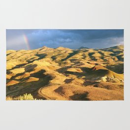 An intense rainbow in the painted hills Rug