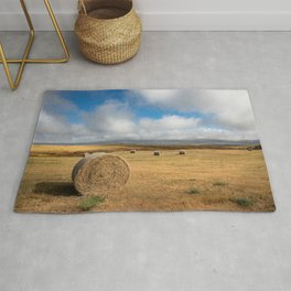 A Day on the Prairie - Round Hay Bales on Golden Landscape in South Dakota Rug