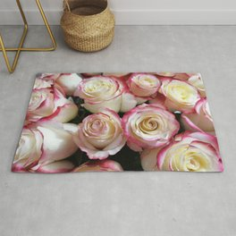 Delicate pink flowers and buds, of a background of delicate roses Rug
