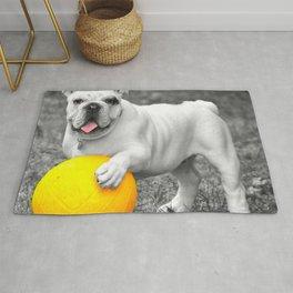 English bulldog white and the yellow ball Rug