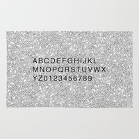 helvetica Area & Throw Rugs featuring Helvetica Jumble by SpareType