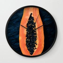 Papaya cross-section on dark slate Wall Clock