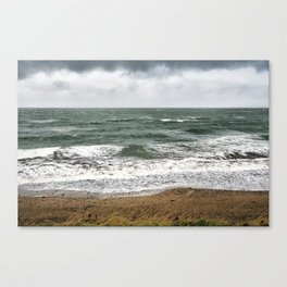 Land and sea under stormy clouds Canvas Print