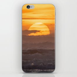 Close-up of Sun Settings Over Ocean Waves iPhone Skin