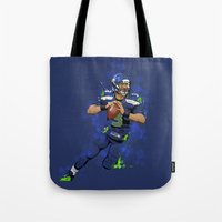seahawks Tote Bags featuring Russell Wilson QB 3 Seattle Seahawks by Akyanyme