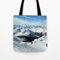 low poly Tote Bags featuring low poly mountains by tony tudor