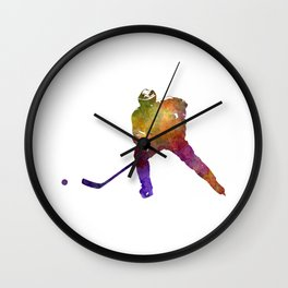 Hockey skater in watercolor Wall Clock