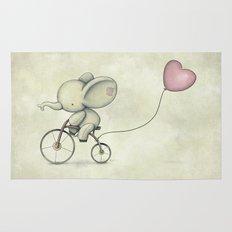 Cute Elephant riding his bike Rug