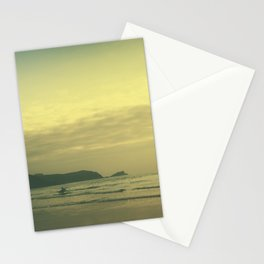 Tilt and shift sun down surfer, Fistral Beach, Newquay, Cornwall Stationery Cards