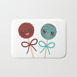 cute funny kawaii chocolate and blue Sweet Cake pops set with bow on white background Bath Mat