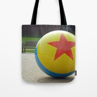 toy story Tote Bags featuring Toy Story Ball by Jillian