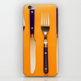 blue forks and knives on orange background iPhone Skin