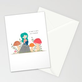 Be down to earth like mushroom; Cute girl sitting on stone Stationery Cards