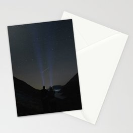 Young couple watching shooting stars in the mountains. Cumbria, UK. Stationery Cards