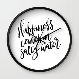 Happiness comes in salty water. Wall Clock