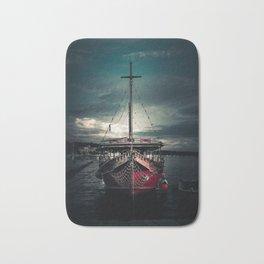 Sailboat in harbor Bath Mat