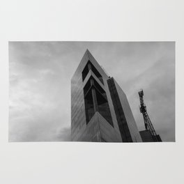 Rising Monsters in the City (black and white) Rug
