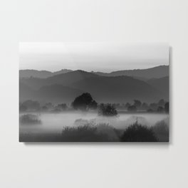 Fog rolling through valley in black and white Metal Print