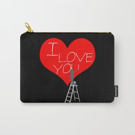 A Woman Worker Stands On A Step Ladder And Chisels I Love You In Red Heart. Black Background Carry-All Pouch