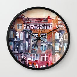 Apartment House in Poznan and orange umbrellas Wall Clock