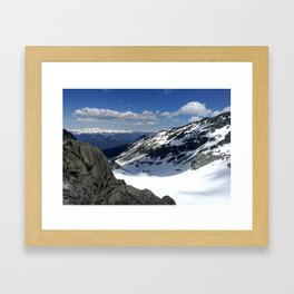 Mountains dappled with snow and rock Framed Art Print