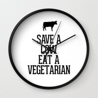 vegetarian Wall Clocks featuring Save a Cow Eat a Vegetarian by RexLambo