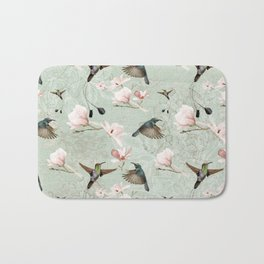 Vintage Watercolor hummingbird and Magnolia Flowers on mint Background Bath Mat