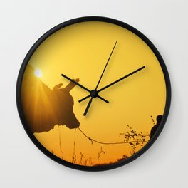 Two boys taking their bull for a stroll Wall Clock