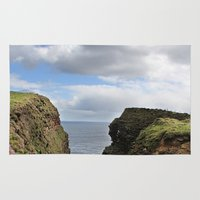 scotland Area & Throw Rugs featuring John O Groats Scotland by Roger Wedegis