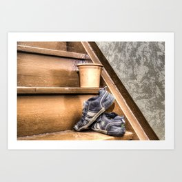 Old children's shoes on a stairway Art Print