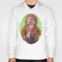 budi Hoodies featuring Budi the Rescued Baby Orangutan by Alina Bachmann