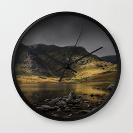 A Light in the Shadows Wall Clock