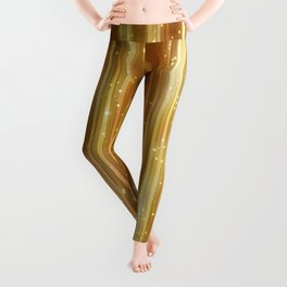 Bright abstract golden background with glitter Leggings