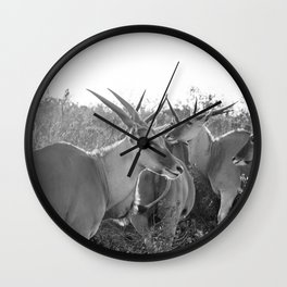 Herd of Eland stand in tall grass in African savanna Wall Clock