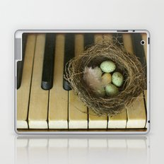 Chocolate Eggs in a Birds Nest on a Vintage Piano. Laptop & iPad Skin