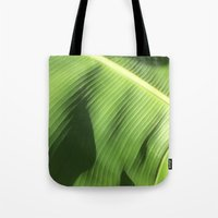 banana leaf Tote Bags featuring Banana Leaf by Glenn Designs