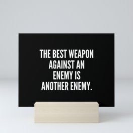 The best weapon against an enemy is another enemy Mini Art Print