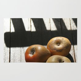 Three apples on a chair Rug