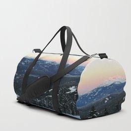 Snowboarding downhill at sunset Duffle Bag