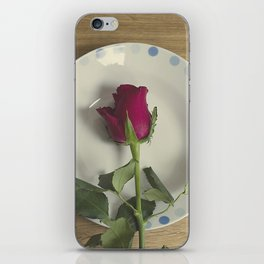 Red rose on a plate iPhone Skin