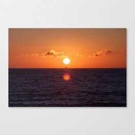 between suns and over  the oceans Canvas Print
