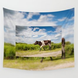 Calf walking in natural landscape Wall Tapestry
