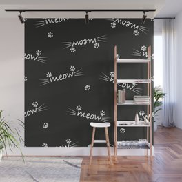 Meow text with doodle cat paw prints black background Wall Mural