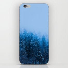 Fog over snow covered forest at lake Bohinj, Slovenia iPhone Skin
