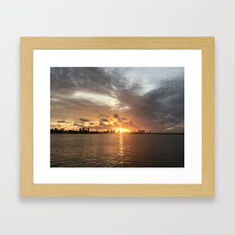 Sunset in Miami with cloudy sky and calm sea Framed Art Print