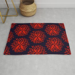 Large warm red flower petal burst pattern on black Rug