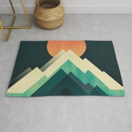 Ablaze on cold mountain Rug