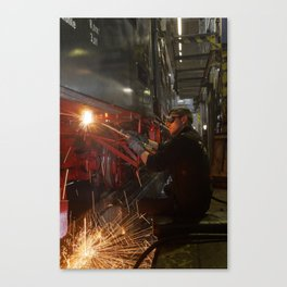 Welding works on a steam locomotive. Canvas Print